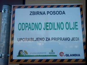 Zastavica na posodi Qlandia Nova Gorica